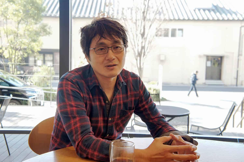 アマナ開発部門 兼 アマナイメージズ取締役の松田 達也さん。アマナイメージズのサイト運営、システム開発を担当する